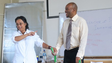 Vanessa de Kauwe leading a visually impaired student's first ever practical science demonstration